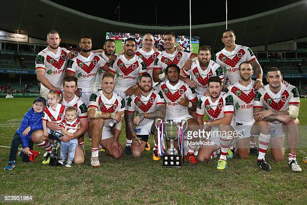 The Dragons pose with the ANZAC trophy after victory during the round eight NRL match between the St George Illawarra Dragons and the Sydney Roosters...