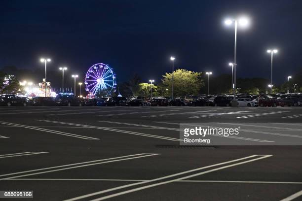 The Dream Wheel ride stands in the parking lot of the Neshaminy Mall during the Dreamland Amusements carnival in Bensalem Pennsylvania US on Saturday...