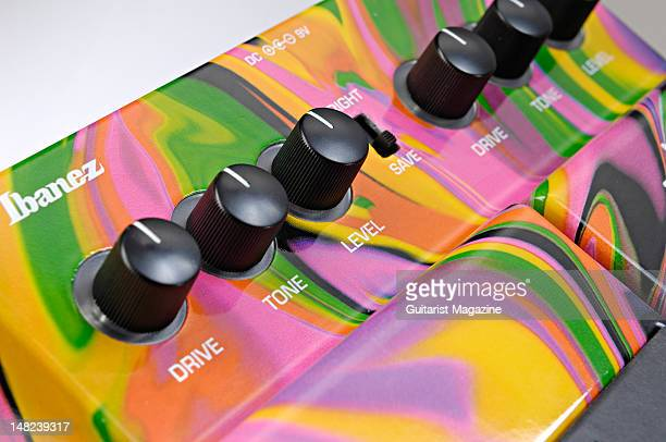 The drive tone and volume controls of an Ibanez Jemini Steve Vai Signature electric guitar distortion pedal during a studio shoot for Guitarist...