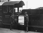 The driver and fireman of the Great Western Railway 'Castle' class locomotive 'Restormel Castle' holding a poster advertising a special train from...