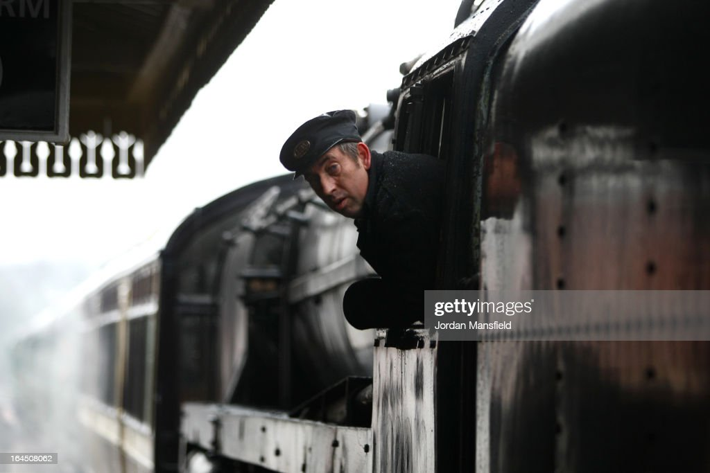 The driver of a locomotive looks out his carriage upon arrival at Sheffield Park Station on March 23, 2013 in Fletching, England. The Bluebell Railway ran its first steam train this weekend on the reclaimed line from Kingscote to East Grinstead after volunteers from the Bluebell Society worked to reopen the line after its closure on March 17, 1958. 50 years on from Dr. Richard Beeching's report signaling the widespread closure of rural rail routes across the UK, Britain's railways are in great demand with old lines reopening and pressure on to restore rural lines that were closed.