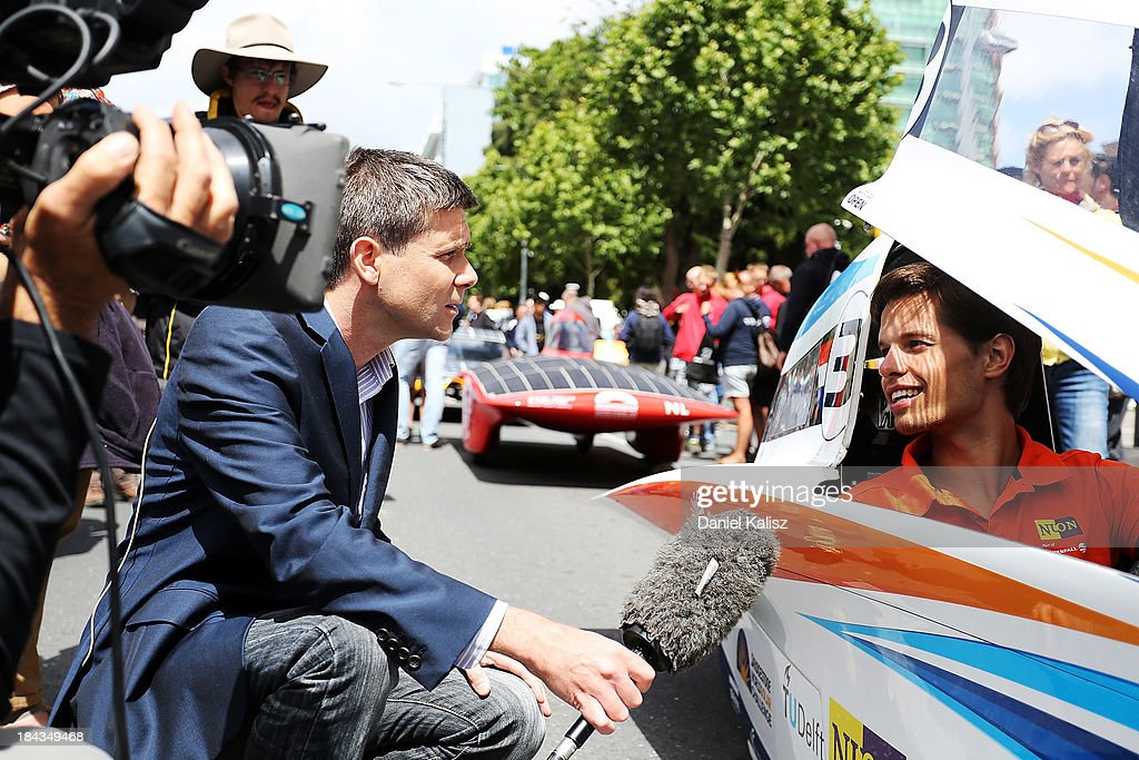 The driver of Nuon Solar Team, Challenger Class from the Netherlands is interviewed during the 2013 World Solar Challenge street parade on October 13, 2013 in Adelaide, Australia. Over 25 teams from across the globe competed in the 2013 World Solar Challenge, a 3000 km solar-powered vehicle race between Darwin and Adelaide, which was won by Dutch team Nuon from the Delft University of Technology.