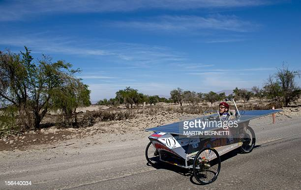 The driver of the Chilean team Atenea II competes in the first stage of the Atacama Solar Challenge a solar car race in the Atacama Desert in...