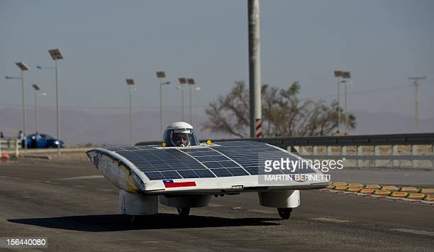 The driver of the Chilean team DasUdec competes in the first stage of the Atacama Solar Challenge a solar car race in the Atacama Desert in northern...