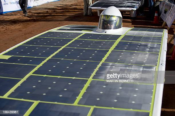 The driver of the Chilean team Eolian 3 gets ready for the start of the first stage of the Atacama Solar Challenge a solar car race in the Atacama...
