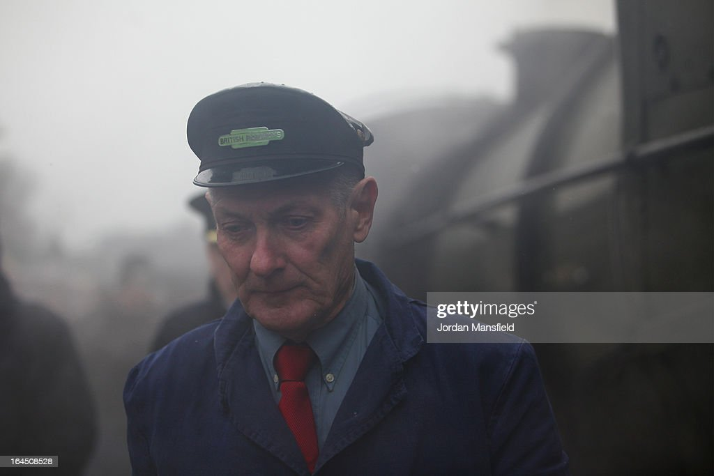 The driver of the Grinsteade Belle arrives at East Grinstead Station for the first time on March 23, 2013 in East Grinstead, England. The Bluebell Railway ran its first steam train this weekend on the reclaimed line from Kingscote to East Grinstead after volunteers from the Bluebell Society worked to reopen the line after its closure on March 17, 1958. 50 years on from Dr. Richard Beeching's report signaling the widespread closure of rural rail routes across the UK, Britain's railways are in great demand with old lines reopening and pressure on to restore rural lines that were closed.