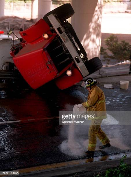The driver of this concrete mixer was killed Tuesday afternoon when he lost control of the truck on the interchange ramp of the 101 freeway and Hiway...
