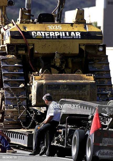 The driver sitting on the back of his tractor–trailer truck hauling the Caterpillar crashed into the Avenida Banderas bridge on the southbound 241...