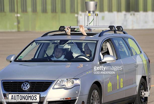 The driverless car 'Made in Germany' which from the outside looks like a regular Volkswagen Passat with a camera on top is being put through its...