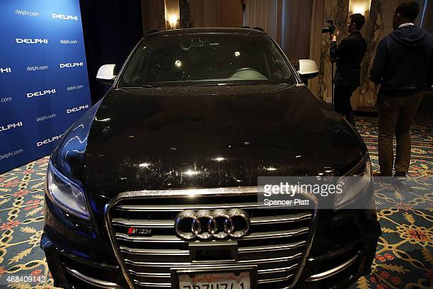 The driverless specially outfitted Audi Q5 sportutility vehicle is displayed at the Waldor Astoria following the car's return from a cross country...