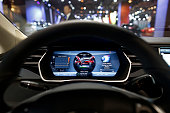 The driver's electronic dashboard sits illuminated inside a Tesla Model S automobile produced by Tesla Motors Inc at the Paris Motor Show on the...