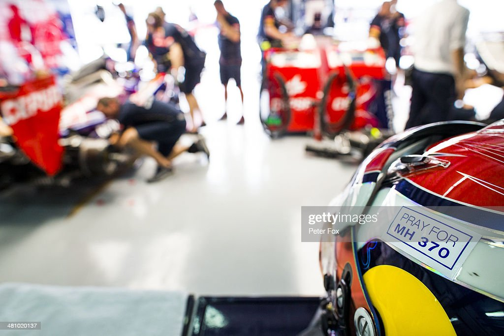 The drivers helmet of Daniil Kvyat of Russia and Scuderia Toro Rosso wears an inscription in memory of Malaysian Airlines flight MH370 during practice for the Malaysia Formula One Grand Prix at the Sepang Circuit on March 28, 2014 in Kuala Lumpur, Malaysia.