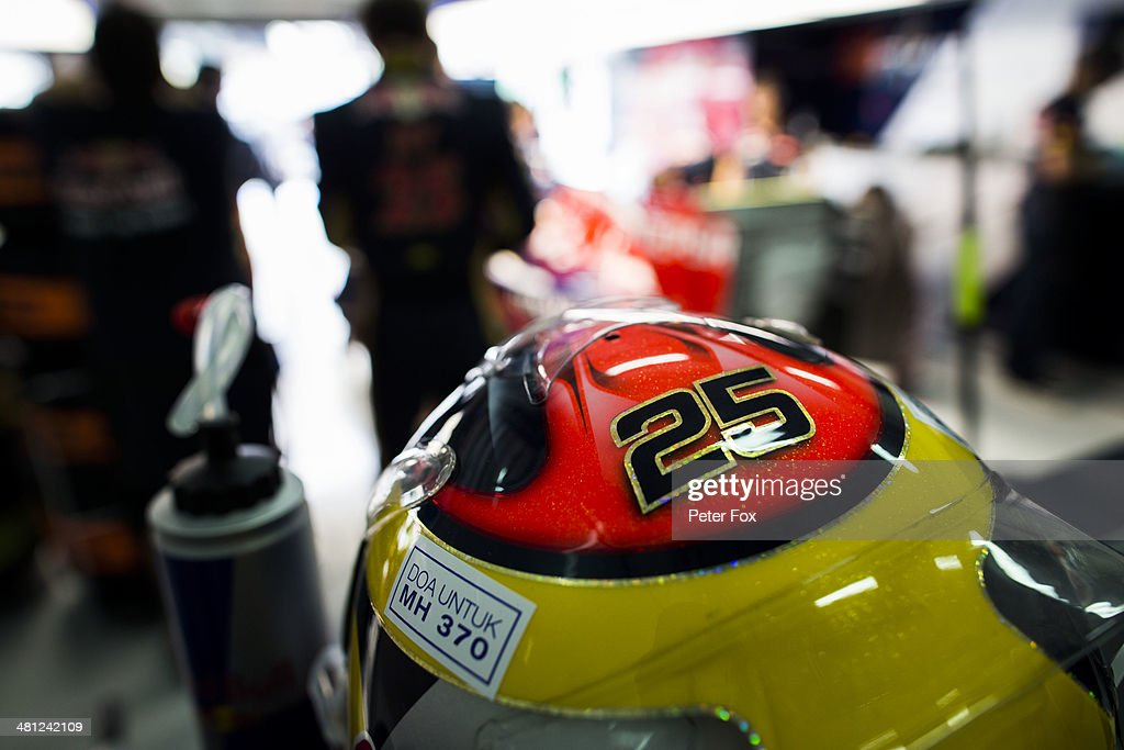 The drivers helmet of Jean-Eric Vergne of France and Scuderia Toro Rosso bears and inscription in memory to Malaysian Airlines flight MH370 prior to qualifying for the Malaysia Formula One Grand Prix at the Sepang Circuit on March 29, 2014 in Kuala Lumpur, Malaysia.