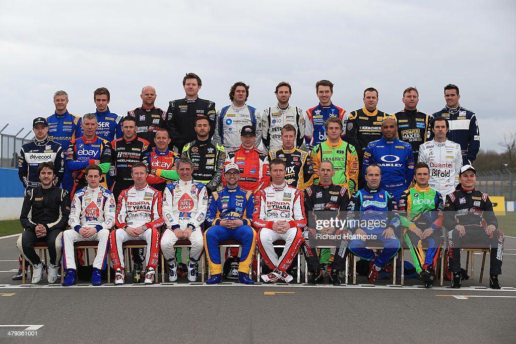 The drivers line up for a group photo during the 2014 Dunlop MSA British Touring Car Championship media day at Donington Park on March 18, 2014 in Castle Donington, England.