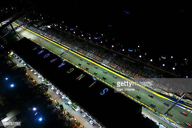 The drivers line up on the grid for the start of the Formula One Grand Prix of Singapore at Marina Bay Street Circuit on September 20 2015 in...