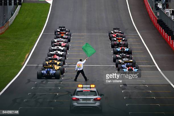 The drivers prepare to start the Formula One Grand Prix of Austria at Red Bull Ring the home of Red Bull Racing on July 3 2016 in Spielberg Austria