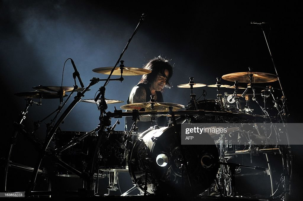 The drummer for Mexican band Mana, Alejandro González, performs during the 'Drama y Luz' World Tour at the National Footbal Stadium in Managua on March 16, 2013. AFP PHOTO / Hector RETAMAL