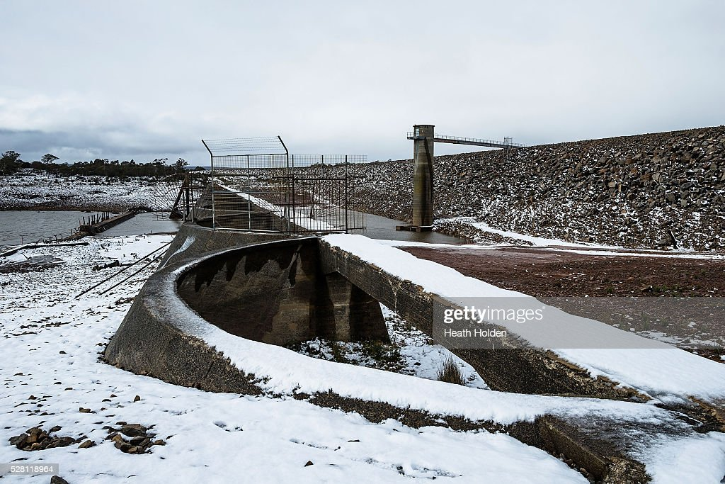The dry dam wall turns white after several days of rain and snow on on May 4, 2016 in Great Lake, Australia. Heavy snow and rain fall in the area has seen much needed water flow into the lake. Tasmania's dams are at record lows due to lower than average rainfall with storage levels of dams used to generate hydro power below 15 per cent for the first time.
