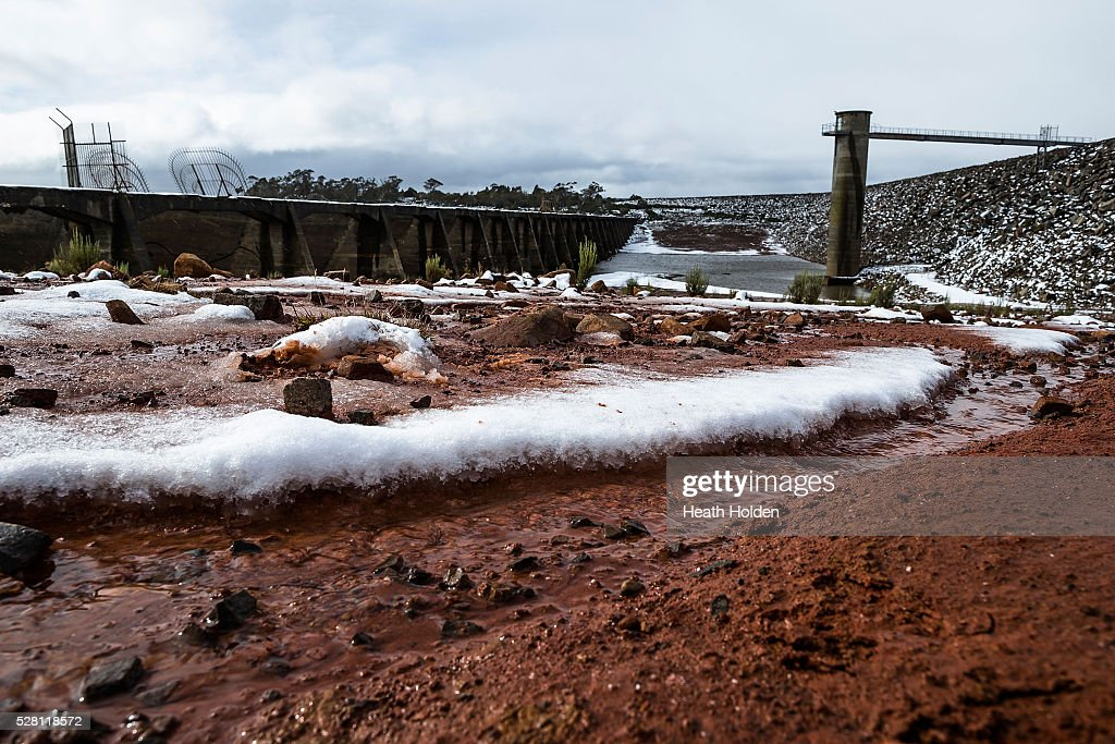 The dry red dirt has turned into deep mud after several days of rain and snow on on May 4, 2016 in Great Lake, Australia. Heavy snow and rain fall in the area has seen much needed water flow into the lake. Tasmania's dams are at record lows due to lower than average rainfall with storage levels of dams used to generate hydro power below 15 per cent for the first time.