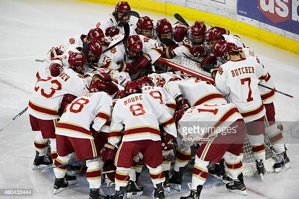 The DU Pioneers gather around the goaltender Tanner Jaillet before the start of the game against North Dakota at Magness Arena December 14 2014