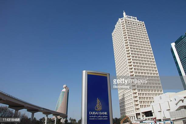 The Dubai Bank PJSC company logo is seen alongside the Etisalat Tower left and the Dubai World Trade Center right in Dubai United Arab Emirates on...