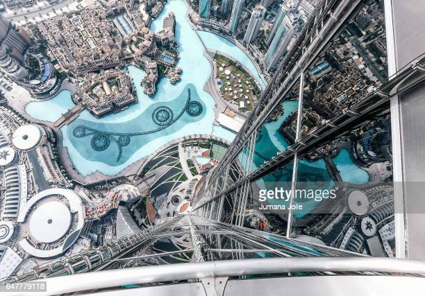The Dubai Fountain and exterior of Burj Khalifa are seen from the 124th floor of the Burj Khalifa on February 8 2017 in Dubai United Arab Emirates...