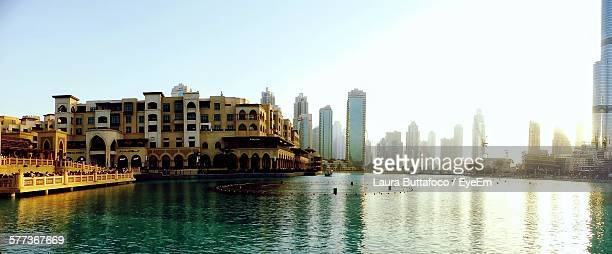 The Dubai Fountain By Cityscape Against Sky
