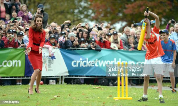 The Duchess of Cambridge fields the ball as the Duke and Duchess of Cambridge participate in a 2015 Cricket World Cup event in Christchurch during...
