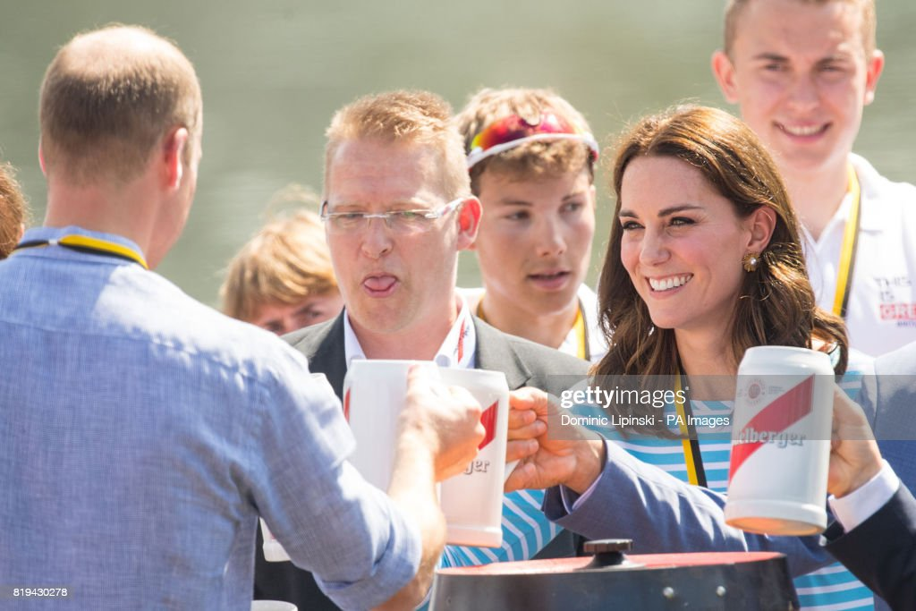 The Duchess of Cambridge makes a toast with the Duke of Cambridge after taking part in a rowing race between teams representing the twinned towns of Heidelberg and Cambridge in Heidelberg, Germany, on day three of their five-day tour of Poland and Germany.