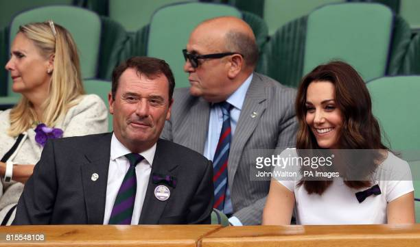 The Duchess of Cambridge Patron of the All England Lawn Tennis and Croquet Club with Chairman of the AELTC Philip Brook on day thirteen of the...