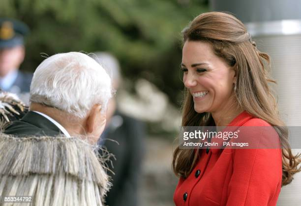 The Duchess of Cambridge performs a traditional greeting as the Duke and Duchess of Cambridge are greeted by members of the Ngai Tahu iwi as they...