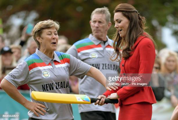 The Duchess of Cambridge prepares to bat to The Duke of Cambridge's bowling as they participates in a 2015 Cricket World Cup event in Christchurch...