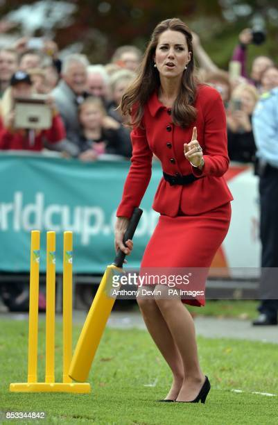 The Duchess of Cambridge reacts after the Duke of Cambridge bowled a full toss delivery as they participates in a 2015 Cricket World Cup event in...