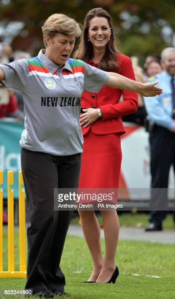 The Duchess of Cambridge smiles as the umpire signals a wide after the Duke of Cambridge bowled a full toss delivery as they participates in a 2015...
