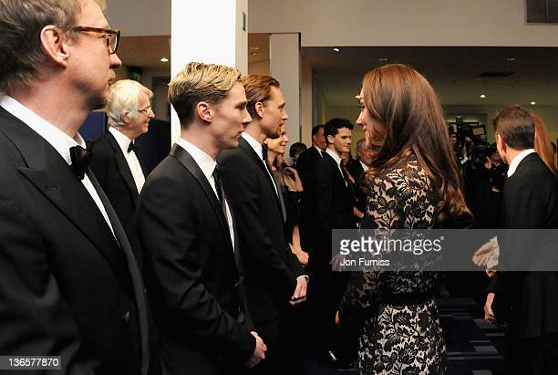 The Duchess of Cambridge speaks with actor Benedict Cumberbatch as they attend the 'War Horse' UK film premiere at the Odeon Leicester Square on...