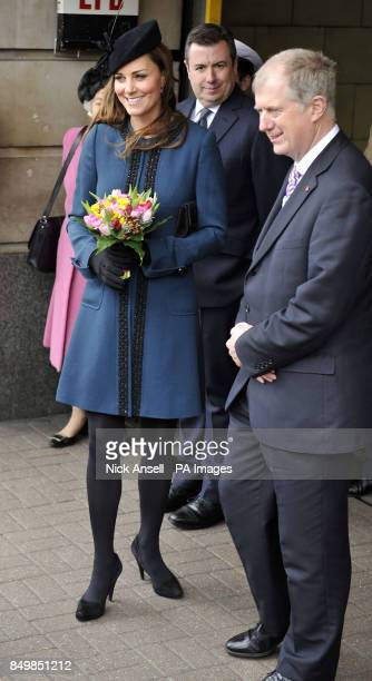 The Duchess of Cambridge stands with Chief Operating Officer at London Underground Howard Collins OBE as she waits to leave Baker Street Underground...
