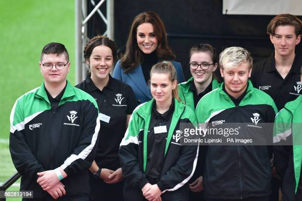 The Duchess of Cambridge stands with some of the 150 Coach Core apprentices as she attends their graduation ceremony at West Ham UnitedOtildes London...