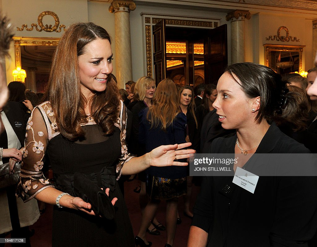 The Duchess of Cambridge talks to gymnast Beth Tweddle during a reception for Team GB Medallists at the 2012 London Olympic and Paralympic Games at Buckingham Palace in London on October 23, 2012. AFP PHOTO / POOL / JOHN STILLWELL