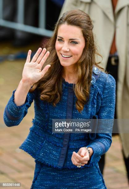 The Duchess of Cambridge waves to the crowd during her walkabout with the Duke in Civic Square Wellington New Zealand during their threeweek tour of...