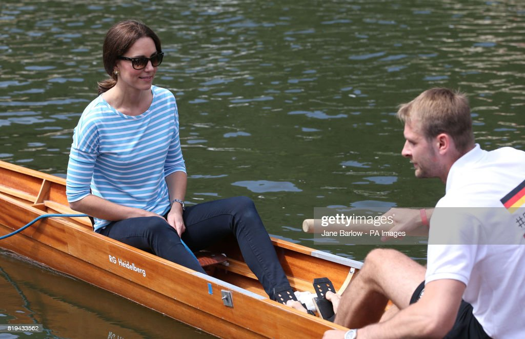 The Duchess of Cambridge with German Olympian Filip Adamski gets ready to take part in a rowing competition on the River Neckar during their visit to Heidelberg on the second day of their three-day tour of Germany.