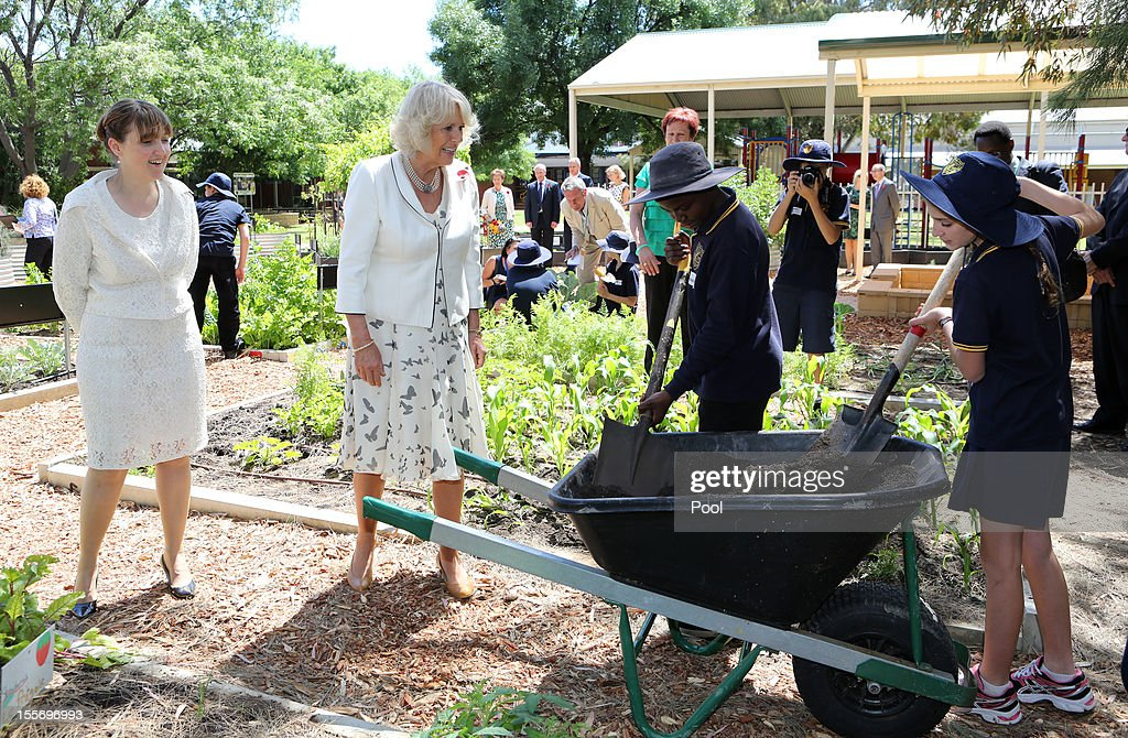The Duchess of Cornwall (C), accompanied by the South Australia Minister for Education and Child Development, Grace Portolesi, as they talk to school pupils in the organic vegetable garden during a visit to Kilkenny Primary School on November 7, 2012 in Adelaide, Australia. The Royal couple are in Australia on the second leg of a Diamond Jubilee Tour taking in Papua New Guinea, Australia and New Zealand.