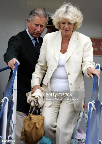 The Duchess of Cornwall and the Prince of Wales leave The Hebridean Princess boat at the end of their weeklong holiday around the Hebrides