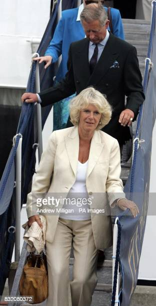 The Duchess of Cornwall and the Prince of Wales leave the The Hebridean Princess boat at the end of her weeklong holiday around the Hebrides