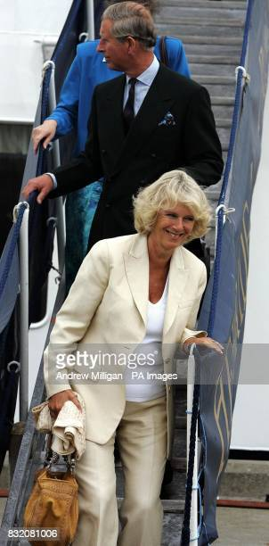 The Duchess of Cornwall and the Prince of Wales leave the The Hebridean Princess boat at the end of their weeklong holiday around the Hebrides