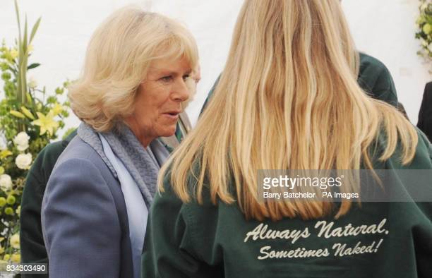 The Duchess of Cornwall chats with a group of people during her tour of Tyrrells Potato Chip factory near Leominster Herefordshire