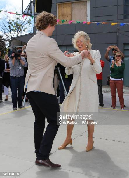 The Duchess of Cornwall dances with Sam Johnson from Christchurch during a visit to the Dance O Mat in the centre of the Capital in New Zealand The...