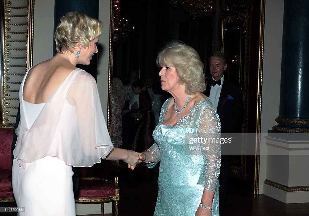 The Duchess of Cornwall greets Princess <a gi-track='captionPersonalityLinkClicked' href=/galleries/search?phrase=Charlene+-+Princess+of+Monaco&family=editorial&specificpeople=726115 ng-click='$event.stopPropagation()'>Charlene</a> of Monaco as she arrives for a dinner for foreign Sovereigns to commemorate the Diamond Jubilee at Buckingham Palace on May 18, 2012 in London, England. Prince Charles, Prince of Wales and <a gi-track='captionPersonalityLinkClicked' href=/galleries/search?phrase=Camilla+-+Duchess+of+Cornwall&family=editorial&specificpeople=158157 ng-click='$event.stopPropagation()'>Camilla</a>, Duchess of Cornwall hosted the event.