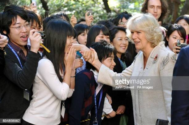 The Duchess of Cornwall greets students at the Keio University in central Tokyo this morning