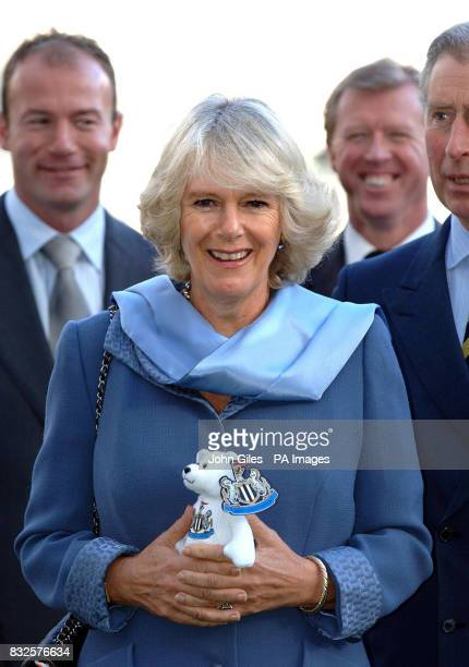 The Duchess of Cornwall holds a Newcastle United teddy bear as she's flanked by Alan Shearer England manager Steve McClaren and the Prince of Wales...