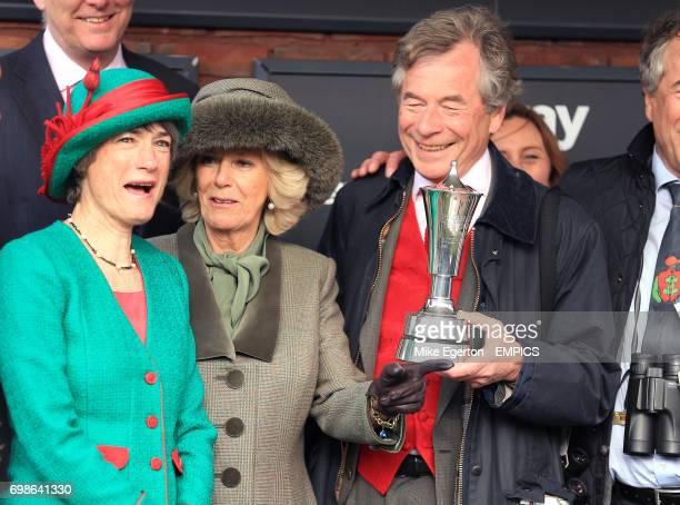 The Duchess of Cornwall makes a presentation to the owners of the winning horse in the Betway Queen Mother Champion Steeple Chase